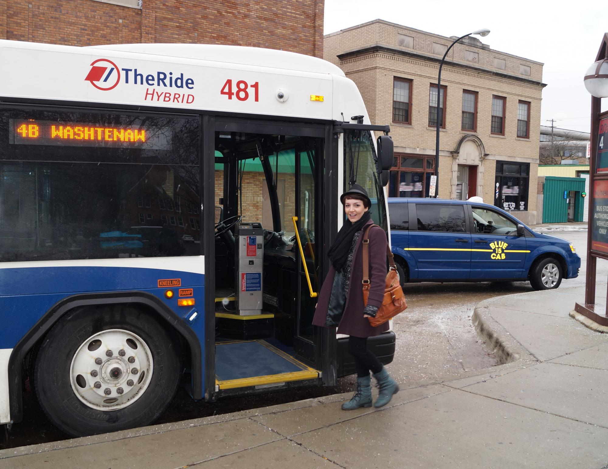 A woman boarding the bus in downtown Ann Arbor.