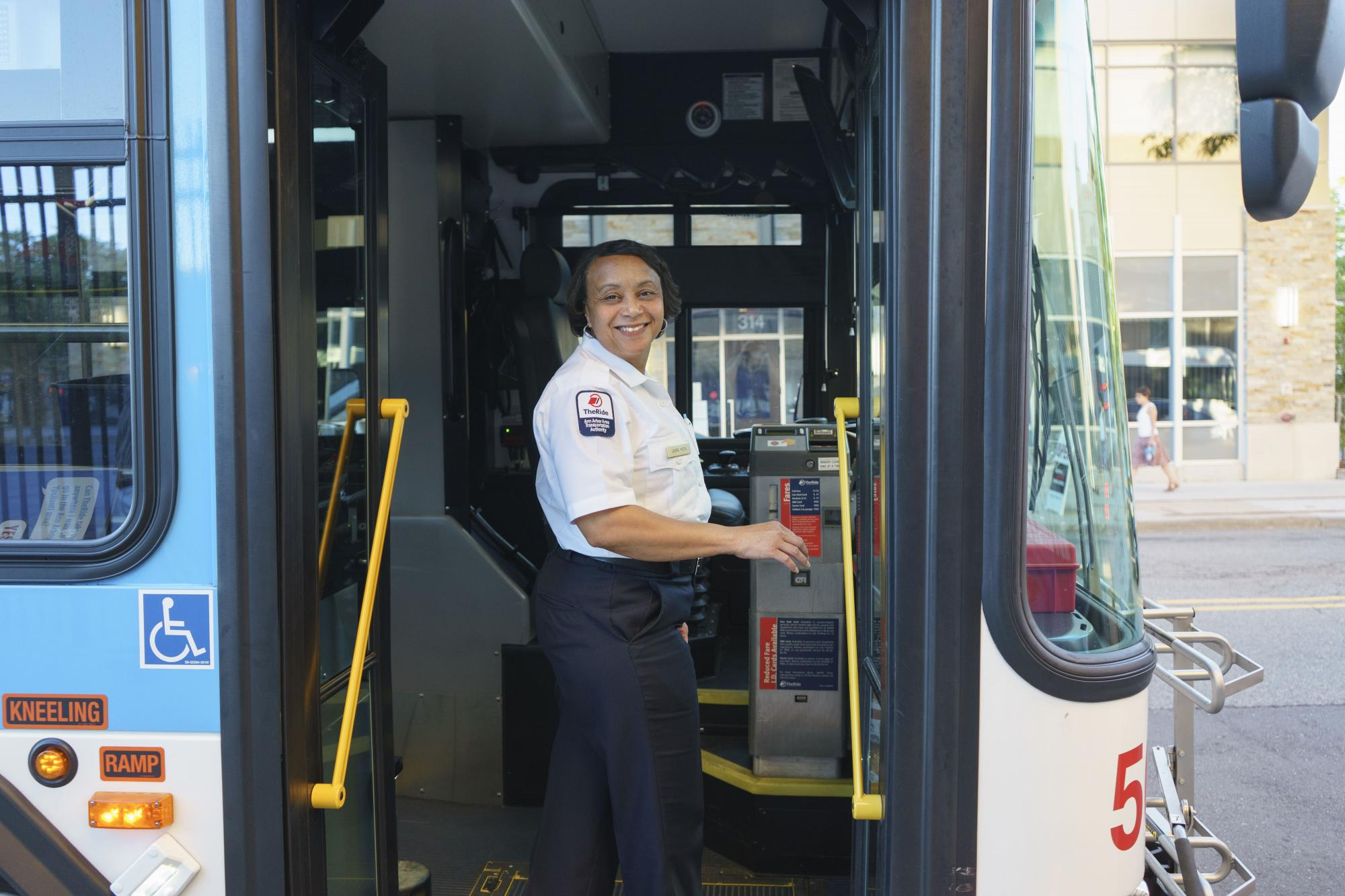 A bus driver gets ready to board her bus for her shift.