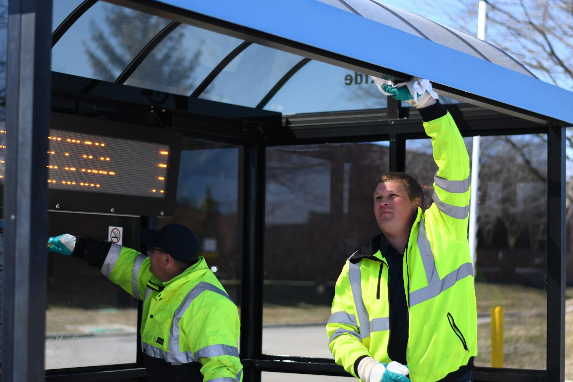 TheRide Facilities team cleans a bus shelter