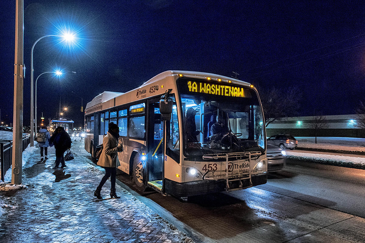 TheRide bus traveling at night in winter