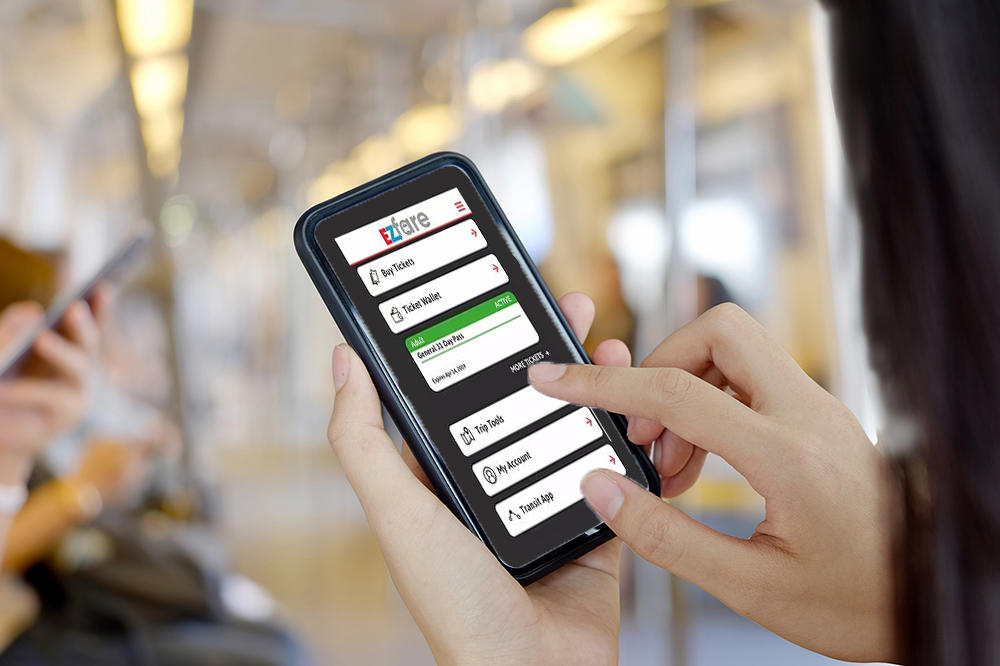 Bus rider using EZFare app on phone